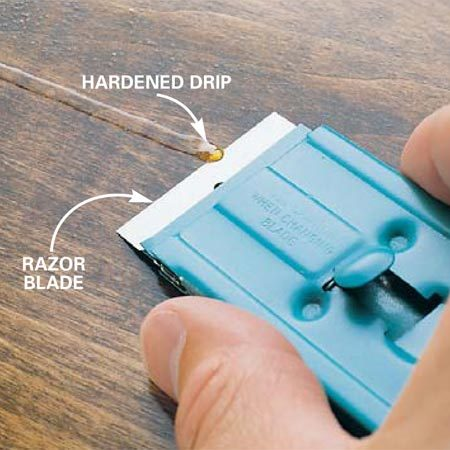 <b>Photo 3: Shave off bumps</b></br> Cut away any dried drips with a razor blade. Don't cut below the surrounding surface. Small blemishes will disappear after you wet-sand the finish.