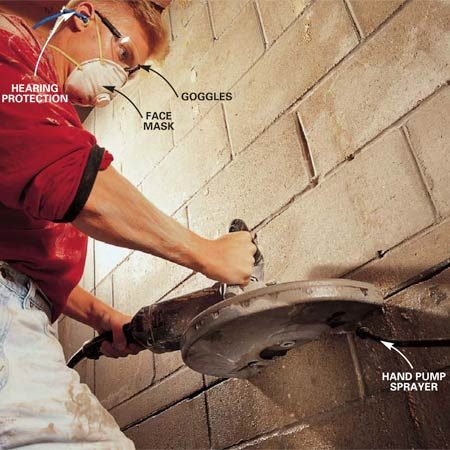 <b>Photo 6: Cut the concrete</b></br> Cut a 1/2-in. deep groove in the concrete block with an electric 14-in. concrete saw equipped with a diamond blade. Then complete the cut on a second pass. Wetting the blade as it cuts reduces dust. Caution: Plug the saw into a GFCI outlet.