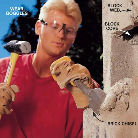<b>Photo 9: Smooth out the opening </b></br> Chip the sides of the opening smooth with a brick chisel. Check to be sure the rough opening is large enough for the rough frame and window.