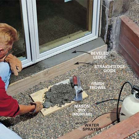 <b>Photo 17: Create a bevel in the ledge </b></br> Bevel the ledge under the window with mortar so it will shed water. Use a straightedge as a guide because your saw cut won't be perfectly straight. Wet the ledge, add the mortar and shape the bevel with a small finishing trowel.