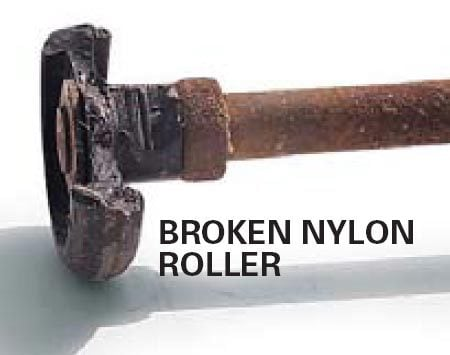 <b>Photo 2: Inspect the rollers for wear and tear</b></br> Nylon rollers tend to crack or chip when they deteriorate, so defects should be easy to spot. On steel rollers, the bearings wear and the wheel begins to tilt like the one shown. Buy replacement rollers at a hardware store and install them by removing and reinstalling the roller bracket. <strong>Caution:</strong> Do not remove the bottom roller bracket. The cable attached to it is under extreme tension.