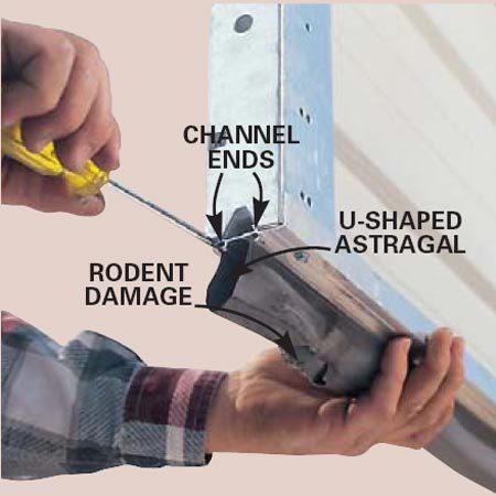 Use a flat-blade screwdriver to open the ends of<br/>the channels that hold the old seal on both ends<br/> of the door. Then pull out the old seal.