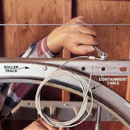 <b>Photo 10: Bolt the cable to the bracket</b></br> Mount an extension spring containment cable on extension spring- type doors by bolting one end to the bracket at the front of the upper rail.