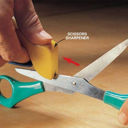 <b>Photo 1: Pull the sharpener</b></br> Align the tungsten sharpener so it sits flat on the scissors blade. Pull the sharpener across the surface from base to tip in one motion. Maintain contact with the surface of the blade. Make several passes and then repeat the procedure for the other blade of the scissors.