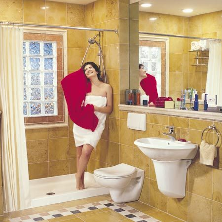 <b>The bathroom after being remodeled</b></br> The remodeled bathroom has an updated look and is highly functional.