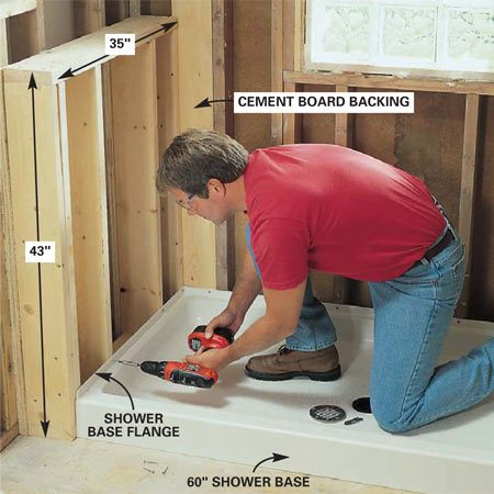 <b>Photo 14: Install the shower base</b></br> Place the shower base and mark the drain location on the subfloor. Remove the base and cut a 6-in. wide hole. Tighten the shower drain to the shower base. Predrill 1/8-in. holes through the mounting flange into the studs and screw the base to the wall studs with 1-5/8-in. galvanized drywall screws.