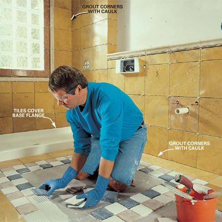 <b>Photo 18: Tile the walls and floor</b></br> Tile the walls first, then the floor. When tiling around the window, keep the tile about 1/8 in. away from the glass block. Tile the floor, starting by carefully snapping center lines to lay out border strips and field tile. Work from those lines to get evenly spaced tiles throughout the floor. Grout the walls and floors but caulk the inside corners between floors and walls and where walls meet.