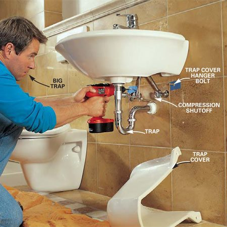 <b>Photo 22: Connect the plumbing </b></br> Connect the sink to the trap and drain line, and the supply lines to the roughed-in copper lines with compression valve shutoffs. Mark, drill and mount the trap cover to the wall with hanger bolts.