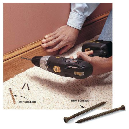 """<b>Photo 6: Install wood trim</b></br> Install wood trim to underlying steel wall framing with self-tapping trim screws. Use a stud finder to locate the wall studs, and mark their position on the trim piece. To avoid splitting the trim, countersink the screwhead with a 1/4-in. bit. Then predrill the hole with a 1/8-in. bit. Set the drill clutch """"light"""" so that the screw doesn't strip out. Drive the screw home and fill the screw hole with putty."""
