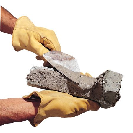 <b>Applying mortar to faux stone</b><br/>Faux stone can be adhered to walls with mortar.