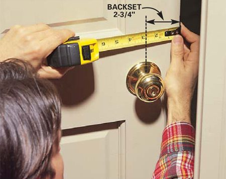 <b>Photo 1: Take measurements to determine the reinforcer size</b><br/>Measure the &ldquo;backset,&rdquo; the distance between the door edge and the center of the door knob; the thickness of the door; and the knob hole diameter. Buy a reinforcer that fits all those measurements.