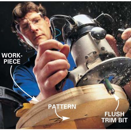 <b>Photo 2: Cut out the shape</b></br> Rout the edge with a flush-cut bit. The bearing on the bit follows the smooth pattern edge.
