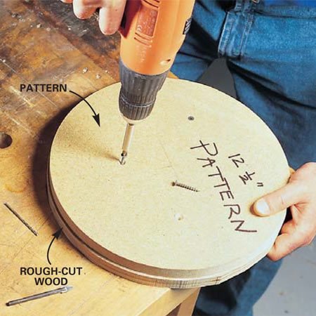 <b>Photo 1: Screw the pattern to the board</b></br> Make a smooth-edged pattern and screw it to the board, which you rough cut to the pattern shape.