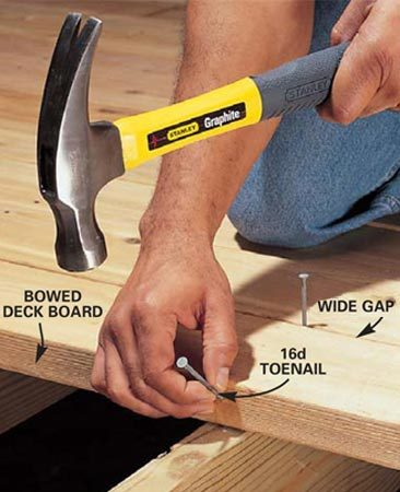 <b>Photo 4: Start the nail in a bowed deck board</b></br> Toenail into the edge of a bowed board to move it closer to the adjoining deck board. Start the nail about one-third down from the top of the board and angle it about 45 degrees to catch the underlying joist.