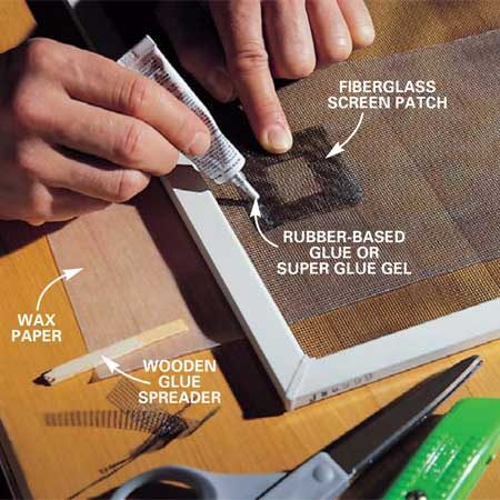 <b>Photo 2: Glue on the patch</b></br> Cut a patch of fiberglass screen that will lap 1/2 in. over each edge. Lay wax paper under the window screen to keep the glue from sticking to the workbench. Center the patch over the hole, apply a bead of glue around the hole, and spread the glue through the patch and window screen using a flat wooden stick.