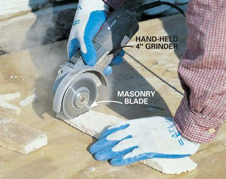 <b>Photo 17: Cut stone to length</b></br> Cut the stone as needed with a hand-held grinder equipped with a diamond-tipped masonry or tile blade (or a circular saw with a diamond blade). Firmly hold the stone on plywood with your fingers well away from the blade.