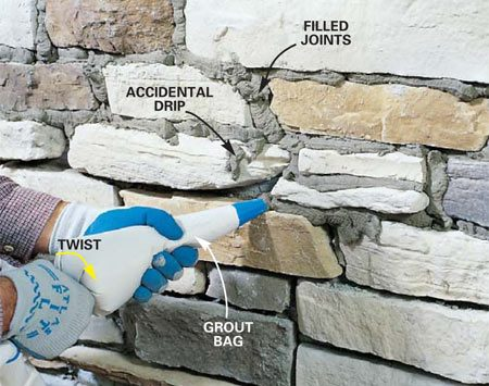 <b>Photo 18: Fill the mortar joints</b></br> Squeeze mortar into all joints, filling them completely, using a grout bag. Start from the top and work your way down. Twist the bag slightly with one hand as you squeeze with the other hand to force the mortar out of the bag. Let the mortar set long enough to hold a thumbprint.