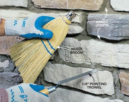 <b>Photo 19: Rake the joints</b></br> Rake the excess back about 1/4 in. from the face of the stone with a 3/8-in. pointing trowel. Then brush loose, crumbled mortar away with a whisk broom.
