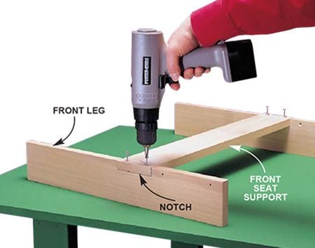 <b>Photo 4: Build the front leg assembly</b></br> <p>Cut and notch the front legs (E) with a jigsaw. Then glue and screw the front seat support into the notches.</p>