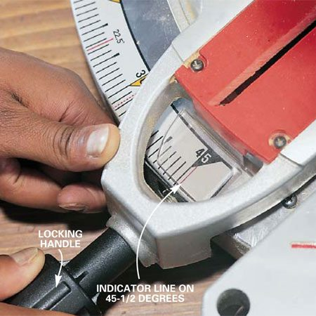 <b>Photo 2: Fine-tune cuts </b><br/>Adjust the blade angle slightly to fine-tune miter cuts for a tight fit. Nudge the blade adjuster and hold it in position until you tighten the locking handle.