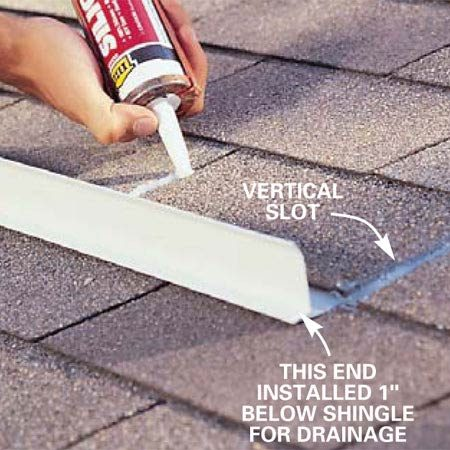 <b>Photo 3: Caulk</b></br> Apply a dab of silicone caulk to the vertical slots in the shingle tabs above the diverter to ensure that water doesn't seep under the top edge of the metal.
