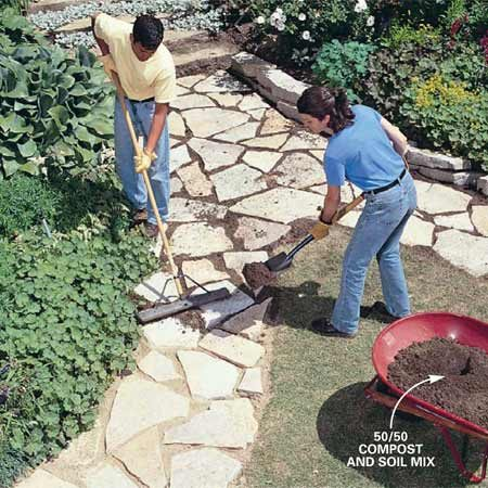 <b>Photo 10: Fill gaps between the stones </b></br> Fill the cracks between stones with a 50/50 mix of potting soil and sifted compost or bark mulch. Spread the soil mix and sweep it into the cracks with a broom.
