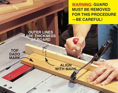 <b>Step 1: First cut </b></br> <p>Make your first cut by aligning the top dado mark with Line No. 1 drawn on the miter gauge fence.<em> This cut establishes one edge of the dado.</em> The line takes into account the thickness of your blade. <strong>Caution:</strong> Blade guard must be removed for this procedure.</p>