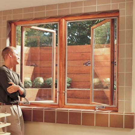 <b>Looking out</b><br/>A terraced window well dramatically increases natural lighting in a lower level or basement. These egress windows satisfy Building Code rules.
