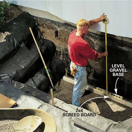 <b>Photo 4: Level a gravel base</b><br/>Dump in a layer of 3/4-in. gravel, then add pea gravel until the surface is 6 in. below the rough window opening (Fig. A). Use a 2x4 to flatten and level the gravel. If you haven't cut the opening yet, mark the rough opening clearly so you don't overfill the hole.