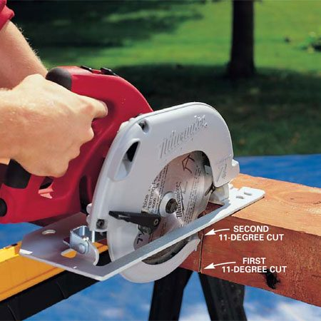 <b>Photo 5: Cut timbers from opposite sides</b><br/>Cut the 4x6 timbers with a circular saw set at an 11-degree angle. It will take two passes to complete the cut. As you cut the timbers to length, remember to adjust the length to alternate the overlap at the corners.
