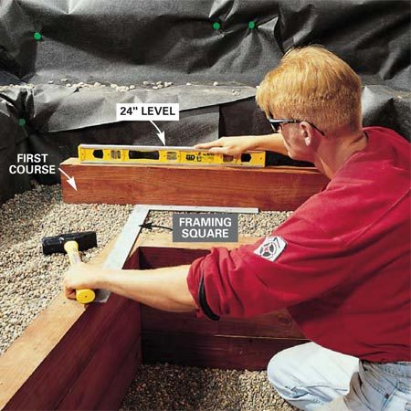 <b>Photo 8: Position the next level</b></br> Use a framing square to establish the setback from the previous wall (12 in. on the side and 14 in. on the front). Tie the first course together (two side pieces and a front) with two 3-in. screws at the joints. Then tamp the course perfectly level with a hammer.