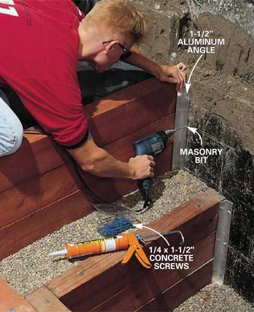 <b>Photo 12: Predrill for concrete anchors</b><br/>Predrill 5/16-in. holes in 1-1/2 in. aluminum angle, hold it in place and predrill 3/16-in. holes into the concrete with a masonry bit.