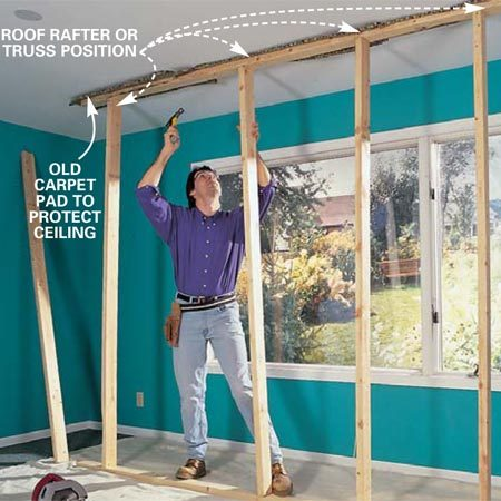 <b>Photo 1: Build a support wall under the ceiling joists. </b></br> Install a temporary support wall 2 to 3 ft. from the exterior wall. Position studs directly under each truss or ceiling joist. Turn off power to any outlets or switches in the wall.