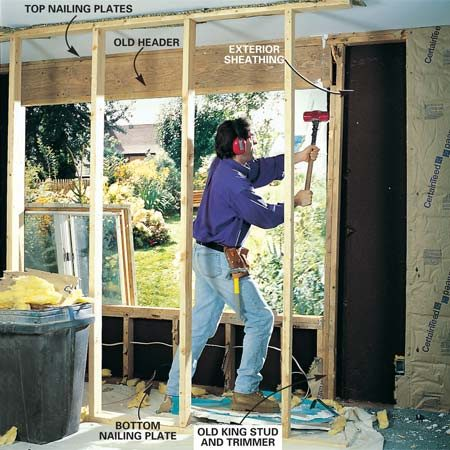 <b>Photo 3: Remove the studs next to the window. </b></br> Remove the drywall or plaster, then the framing that formed the old window opening. Use a reciprocating saw to cut through nails securing the exterior sheathing to the framing. Use a BIG sledgehammer to bash the studs and trimmers away from the header, then use a BIG pry bar—a 3-ft. one gives you lots of leverage—to pry the old header down and away from the top nailing plates.