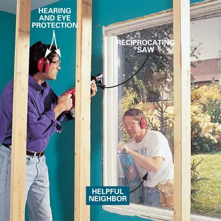 <b>Photo 2: Cut through the finish nails to remove the window. </b><br/>Cut through finish nails securing the window using a reciprocating saw. Cut back the siding with a circular saw if necessary to expose the nailing fins that hold the window in place. Remove the window.
