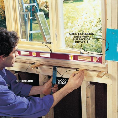 <b>Photo 8: Shim the window to make it level. </b><br/>Level the windowsill with shims every 16 in. Move the window in or out until the extension jamb is even with a scrap of material the same thickness as the finished wall. Use your 4-ft. level to make certain the sides are plumb and the window square, then install shims every 16 in. Drive 10d finish nails through all the shims to secure the window in the rough opening.