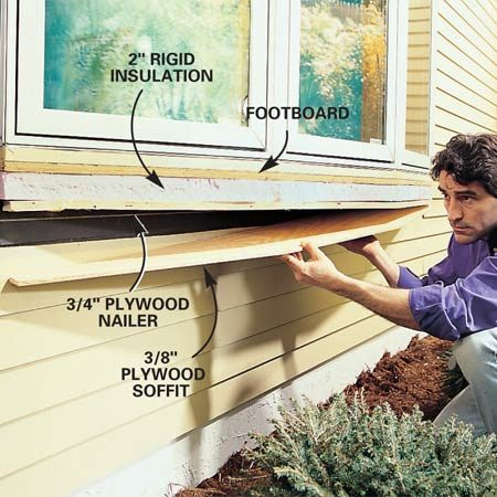<b>Photo 11: Trim the window bottom.</b><br/>Enclose the window bottom. Use big-head, plastic cap nails to secure 2-in. rigid insulation to the footboard, then secure the 3/4-in. plywood by driving 3-1/2 in. drywall screws through the insulation and into (but not through!) the footboard. Use 4d galvanized nails to secure the soffit plywood to the 3/4-in. plywood. Keep the edges of all three layers even with the edges of the window.