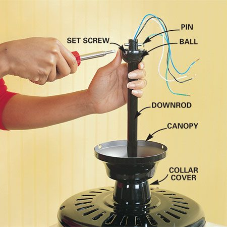 <b>Photo 8: Prepare the hanging ball</b><br/>Slip the collar cover, then the canopy over the downrod. Slide the ball over the downrod and push the pin through both sets of holes, then lift the ball over the pin and tighten the set screw.