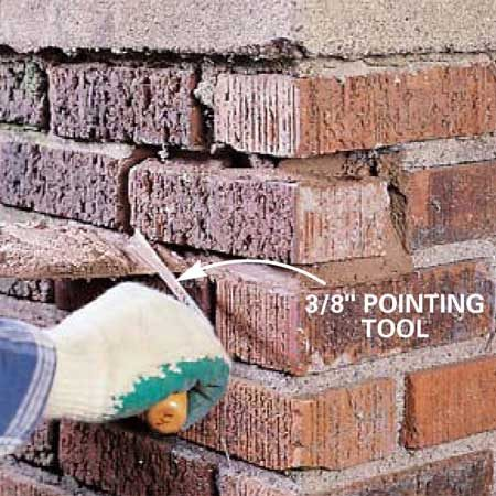 <b>Photo 4: Point the mortar</b></br> Pack the mortar oozing from the joints with a brick trowel and 3/8-in. wide pointing tool. Add more mortar by sliding it directly off the trowel and into the joint. Finish the joint surfaces to match the shape of adjacent joints.