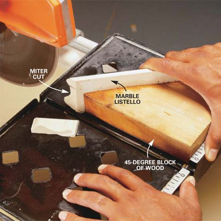 <b>Photo 9: Cut miters with a block</b></br> Hold the tile trim against a block of wood cut at a 45-degree angle. Guide the tile through the saw to cut the angle.