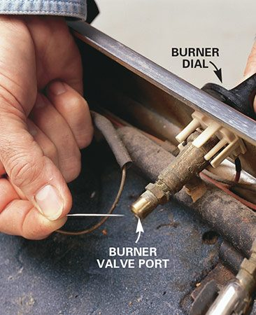 <b>Photo 4: Clean the burner valve</b></br> Stick the needle in the burner valve port a few times to clear any debris.