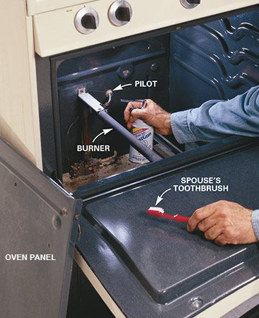 <b>Photo 2: Clean the pilot </b></br> Check to see if the pilot is lit (standing pilot only). It's accessible under the panel  in the oven or from underneath. If it's not lit, clean it. Poke a needle into  the end to clear the nozzle and scrub away debris with a brush. Also clean the  tube or slit under the burner that connects the pilot to the gas ports on the  opposite side of the burner.