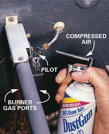 <b>Close-up of pilot</b></br> A burst of compressed air helps clear the soot. Light the pilot.