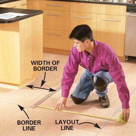 <b>Photo 5: Measure for the border</b></br> Measure from the perpendicular layout lines to mark the exact location of the border. Snap chalk lines for the border and darken them with a pencil.