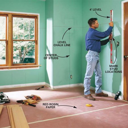 <b>Photo 1: Remove window and door trim</b></br> Pry off window and door moldings and baseboard with a flat pry bar. Measure up from the floor 67 in. and snap chalk lines around the room at that height. Locate the studs with a stud finder and mark the centerline of each with a level. Extend the stud marks about 1 in. above the horizontal chalk line.