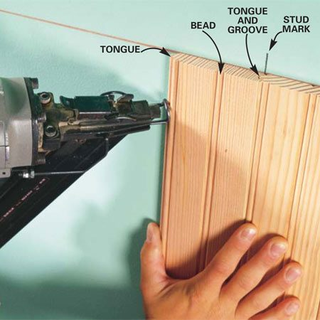 <b>Photo 6: Apply glue and nail</b></br> Drive 1-1/4 in. nails through the tongue into the drywall with a power nailer to hold the boards in place until the glue dries. Drive the nails at about a 45-degree angle. Use three nails in each board.