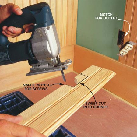 <b>Photo 9: Cut notches with a jigsaw</b></br> Notch boards for switches and receptacles with a jigsaw. Hold the board over the outlet and mark for the top and bottom cuts. Then measure and mark the side cut. Saw straight in at the top. Then cut a sweeping arch into the corner. Cut along the remaining lines and cut small notches for the outlet screws.