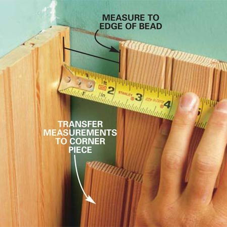 <b>Photo 11: Measure the corner gap</b></br> Measure from the corner to the edge of the board, excluding the tongue, to determine the width of the last board. Measure every 12 in. along the corner and mark these dimensions on the final board. Connect the marks to create a cutting line.