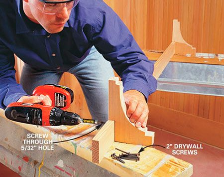<b>Photo 16: Fasten brackets to the rail </b></br> Drill two 5/32-in. pilot holes at each bracket location and attach the brackets to the 1x3s with 2-in. drywall screws. Reinstall the 1x3s. Drive two 2-1/2 in. finish nails into each stud and use a nail set to sink the nailheads slightly below the surface.