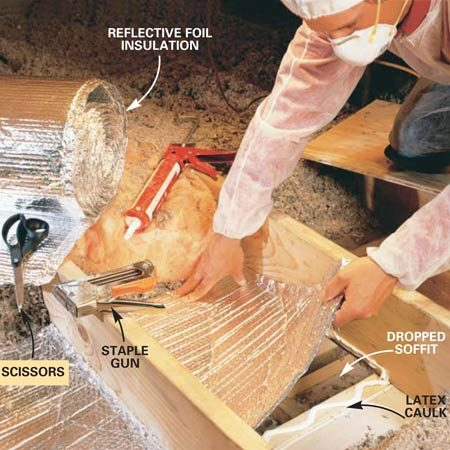 <b>Photo 3: Cover open soffits</b></br> With scissors, cut a length of foil insulation about 6 in. longer than the opening to be covered. Apply a bead of latex caulk around the opening. Embed the foil in the caulk and staple it in place.